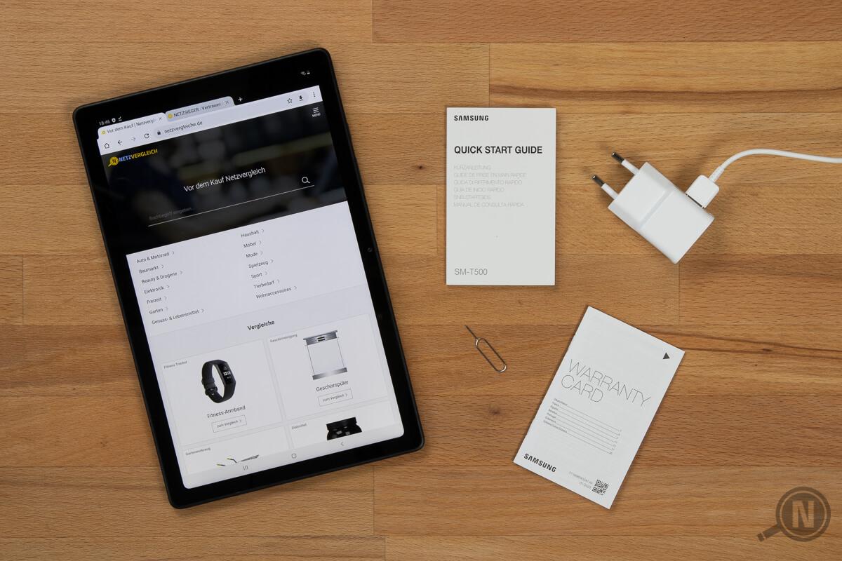 """Tablet mit Packungsinhalt: Ladegerät, SIM-Tool, """"Quick Start Guide"""" und """"Warranty Card"""""""