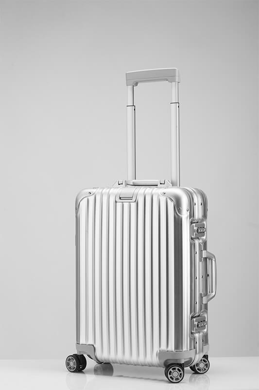 Grauer Koffer
